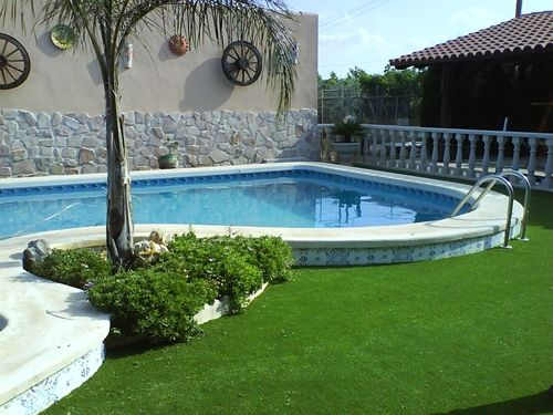 Improve Your Poolside Areas With Artificial Grass