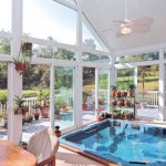 magnificent-indoor-swimming-pool-in-sunroom-designs-ideas-showing-beauty-small-pool-around-pot-plant-near-appealing-polished-wooden-table-surrounds-shining-glass-panel-adorned-lamp-fan-decoration